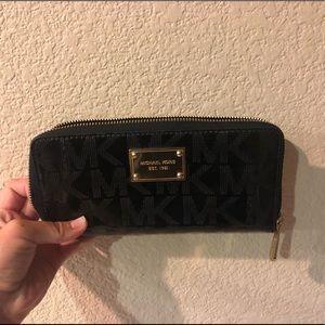 Black vinyl Michael Kors wallet